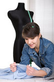 Fashion designer. Young adult fashion designer at work stock photo