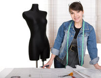 Fashion designer. Young adult fashion designer at work stock photography