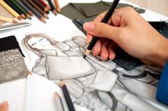 Fashion designer. Is drawing an artistic fashion sketch ,close-up photo Stock Photo