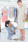 Fashion designer adjusting dress Stock Photo