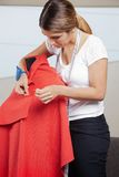 Fashion Designer Adjusting Pins On Fabric Royalty Free Stock Image