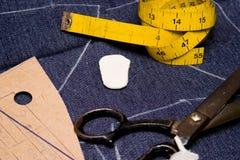 Fashion Designer Atelier. Fashion designer working space in jeans royalty free stock image