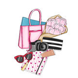Fashion designer bag with various items Stock Photo