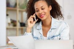 Fashion designer calling her partner Stock Images