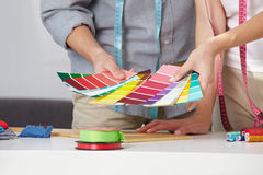 Fashion designer with color samples Stock Photo