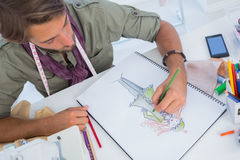 Fashion designer creating a coat for woman royalty free stock image