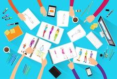 Fashion designer creative team looking models Stock Images