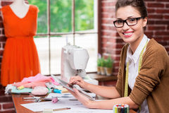 Fashion designer with digital tablet. Stock Image