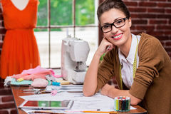 Fashion designer with digital tablet. Royalty Free Stock Image