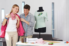 Fashion designer doing a fitting Stock Image