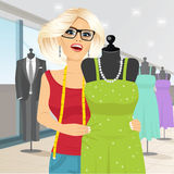 Fashion designer draping a mannequin with a gown Stock Image