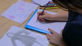 Fashion designer drawing design sketch. Close up shot - hands of professional tailor, designer drawing fashion sketch at atelier, studio. Dressmaking, creativity stock video