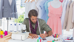 Fashion designer drawing on a desk Stock Photo