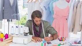 Fashion designer drawing on a desk Stock Photo