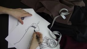 Fashion designer drawing. Hand footage