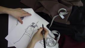 Fashion designer drawing stock video