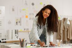 Fashion designer drawing new project Stock Image