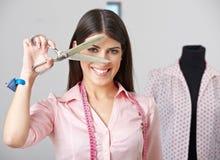 Fashion designer with dressmaker. Happy fashion designer looking through open dressmaker shear stock photography