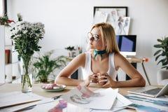Fashion designer drinking coffee Stock Photo