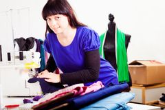 Fashion Designer In Her Studio royalty free stock images