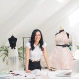 Fashion Designer at Her Studio Stock Photos