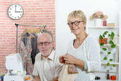 Fashion designer and his assistant working in Royalty Free Stock Images