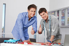 Fashion designer holding thumbs up Stock Images