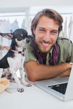 Fashion designer and little dog. Looking at camera royalty free stock photos