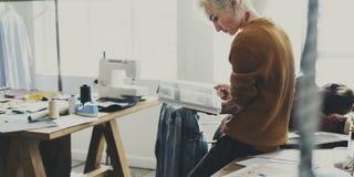 Fashion Designer Magazine Reading Concept Stock Photography