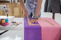 Fashion designer make a suit. Portrait of busy male fashion designer make a suit in his workshop Stock Image