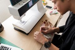 Fashion designer with making dress at studio Stock Image
