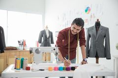 Fashion designer making a new design. Male fashion designer making a new design in his office Royalty Free Stock Images