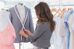 Fashion designer measuring blazer Stock Image