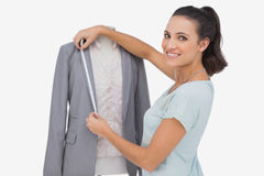 Fashion designer measuring blazer lapel Royalty Free Stock Image