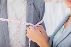 Fashion designer measuring blazer Stock Photography