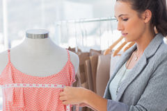 Fashion designer measuring dress Stock Image