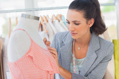 Fashion designer measuring dress in a studio Royalty Free Stock Images