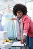 Fashion designer measuring dummy waist Stock Photography