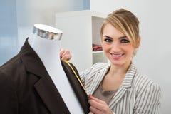 Fashion designer measuring suit royalty free stock image