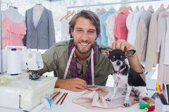 Fashion designer petting his chihuahua Stock Photos
