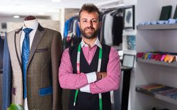 Fashion designer is pleased by created image. In man shop royalty free stock photo