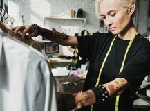 Fashion designer selecting some clothes.  Royalty Free Stock Photography