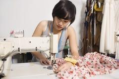 Fashion designer sewing fabric Stock Photography