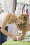 Fashion Designer Sewing Fabric In Studio stock images