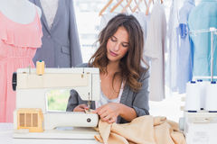 Fashion designer sewing Royalty Free Stock Photo