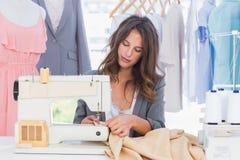 Fashion designer sewing Royalty Free Stock Photo