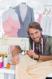 Fashion designer sewing Stock Photo