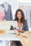 Fashion designer sewing textile Stock Photography