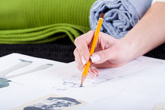 Fashion designer sketching clothes project Stock Images