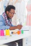 Fashion designer sketching Stock Photos